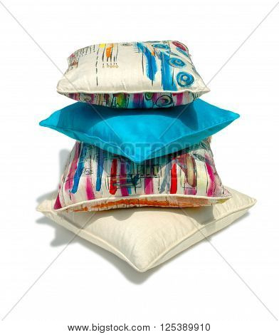 Silk pillows and pillows cases on white background
