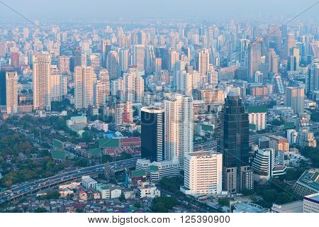 Bangkok's Crowded Skyline In The Hazy, Early Morning Light