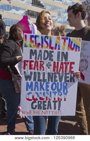 Asheville, North Carolina, USA - April 2, 2016: Close up of a sign about HB2 saying it was legislation made in fear and hate at a rally protesting the new NC law that denies rights to those who are gay or transgender