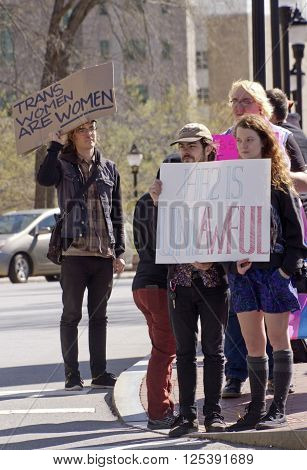 Asheville, North Carolina, USA - April 2, 2016: People hold signs with various opinions about the North Carolina HB2 Law that restricts the rights of those who are gay or transgender
