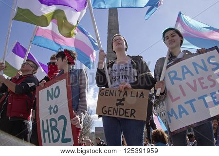 Asheville, North Carolina, USA - April 2, 2016: Crowd holds signs and protests the new North Carolina HB2 Law that restricts the rights of those who are gay or transgender on April 2, 2016 in downtown Asheville, NC