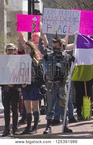 Asheville, North Carolina, USA - April 2, 2016: Crowd holds signs and protests the new North Carolina HB2 Law that restricts rights of those who are gay or transgender