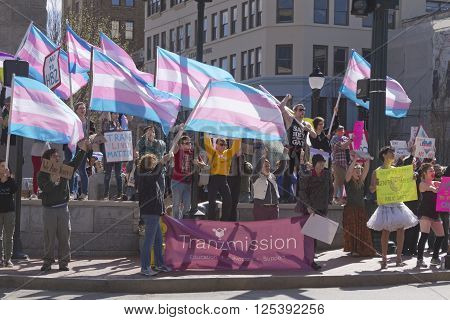 Asheville, North Carolina, USA - April 2, 2016: Crowd holds signs and protests the new North Carolina HB2 Law that restricts rights to those who are gay or transgender