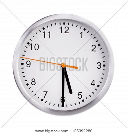 Half past five o'clock on the dial
