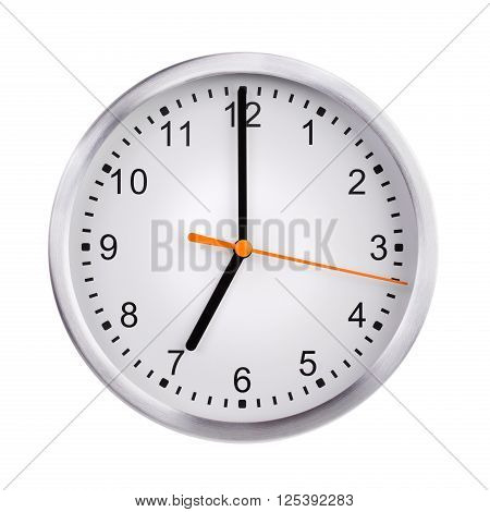 Round the clock shows exactly seven o'clock