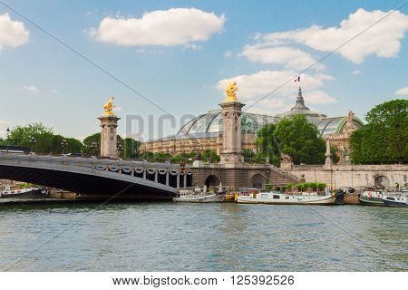 famous Bridge  of Alexandre III over water of  river Seine at summer day, France