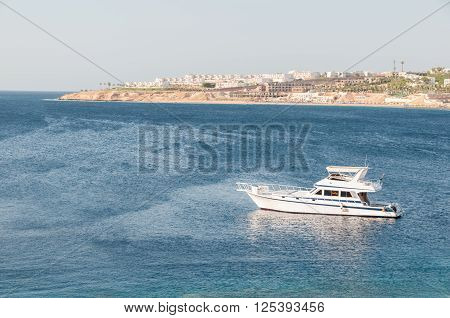 Small Yacht In A Warm, Tropical Bay