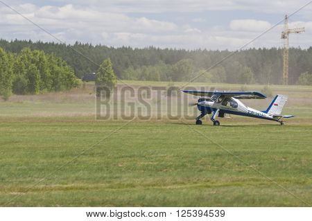 Minsk Belarus-June 21 2014: Airplane PZL 104 Wilga on Takeoff and Landing Strip In Front of Spectators During Aviation Sport Event Dedicated to the 80th Anniversary of DOSAAF Foundation in Minsk on June 21 2014 in Minsk Republic of Belarus