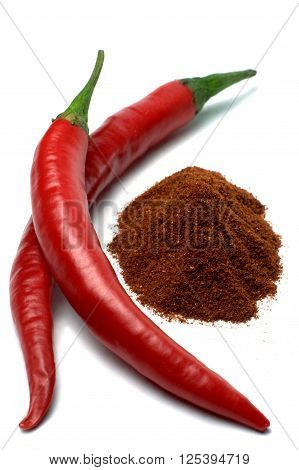Red chili peppers and chili powder isolated on white