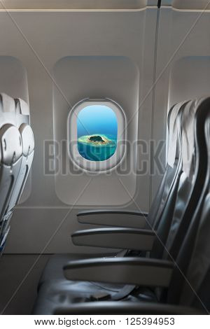 Perspective Shot Of A Tropical Island Through Passenger's Window