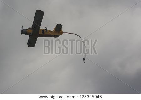 Minsk Belarus-June 21 2014: Parachute Jumpers Performing Air Elements on AN-2 Airplane During Aviation Sport Event Dedicated to the 80th Anniversary of DOSAAF Foundation in Minsk on June 21 2014 in Minsk Republic of Belarus