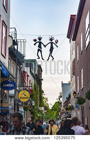 QUEBEC CITY/CANADA - JUNE 12 2010: Artwork dangles over Quebec Lower Town street scene