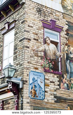 QUEBEC CITY/ CANADA - JUNE 12 2010: One corner of trompe l'oeil murals on Neptune Inn in Quebec City's Lower Town