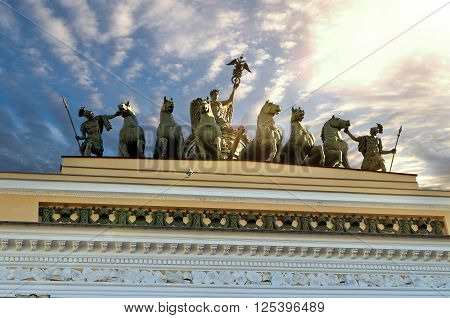Sculptural group named Chariot of Fame lit by sunlight on the roof of the Headquarters in Saint-Petersburg Russia - detailed view