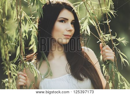 Young Girl Holding A Willow Vine