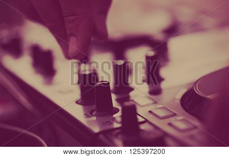 Disc Jockey Playing Music On Midi Controller Turntable