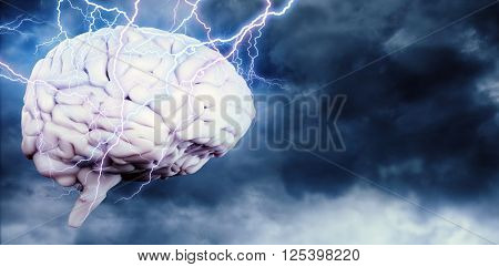 Lightning bolt against blue sky with white clouds