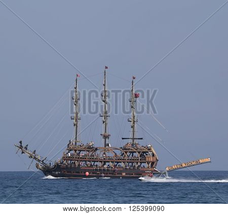 CAMYUVA KEMER TURKEY - JULY 11 2015: On the coast of Turkey widespread various marine activities. Among them walks on boats and yachts stylized pirate schooner
