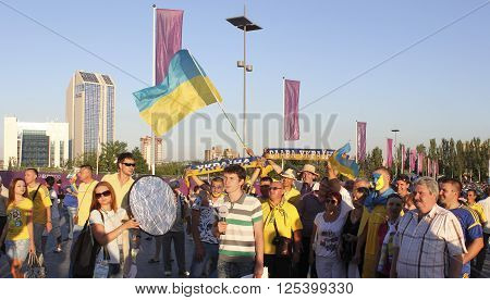 DONETSK UKRAINE - JUNE 19 2012: Unidentified Ukrainian anchorman with soccer fans before UEFA EURO 2012 match in Donetsk on Donbass Arena