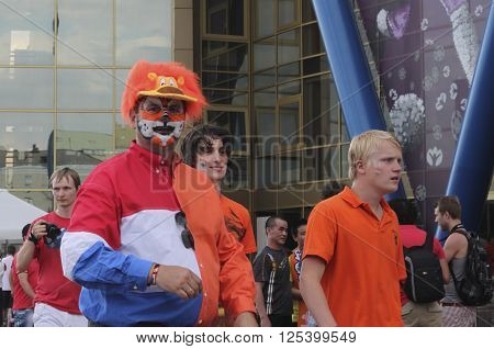 KHARKIV UKRAINE - JUNE 9 2012: Unidentified Dutch soccer fans before UEFA EURO 2012 match in Kharkiv near stadium