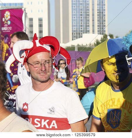 DONETSK UKRAINE - JUNE 19 2012: Unidentified Polish and Ukrainian soccer fans before UEFA EURO 2012 match in Donetsk on Donbass Arena