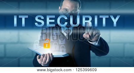 Business manager is pushing IT SECURITY on a virtual touch screen interface. Information technology and computer security concept for the protection of information hardware software and systems.