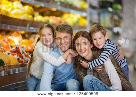 Smiling family in a store
