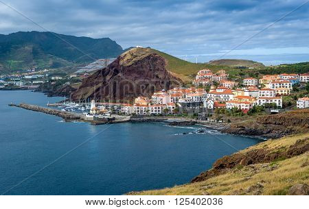Canical small town, lighthouse and yacht marina view. East coast of Madeira island, Portugal.
