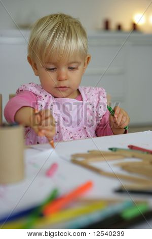 Portrait of a little girl drawing