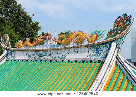 Colorfully Painted Roof Sculptures Of Dragons On A Chinese Temple