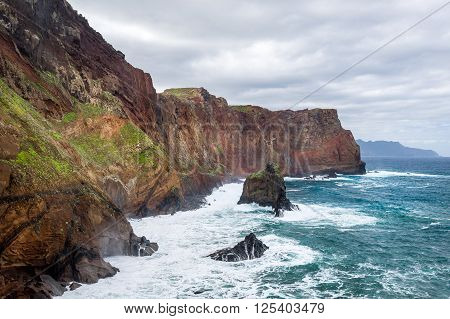 Inaccessible shores of the rocky island in Anlantic ocean. Madeira island coast, Portugal.