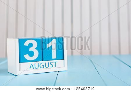 August 31th. Image of august 31 wooden color calendar on blue background. Last Summer day. Empty space for text. Blog Day.