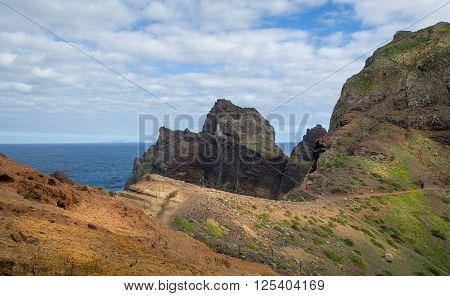 Beautiful hiking path to the astern cape of Madeira islands. Tourists is walking to discover the beauty of Madeira. Portugal.