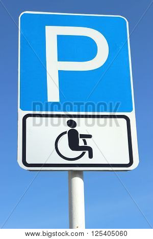 road sign Parking for disabled people on the background of blue sky