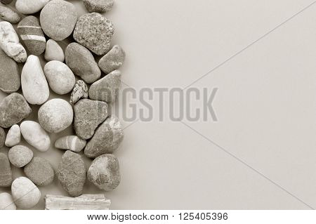 smooth river stone on gray background. zen like concepts. Free space for text. copy space. black and white image
