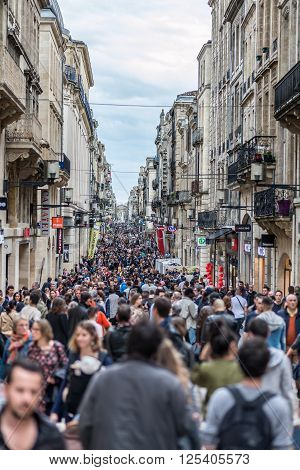 Bordeaux France - March 27 2016. People walking in Rue Sainte Catherine the main shopping street in Bordeaux.
