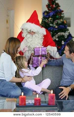 Portrait of a smiling family with Santa Claus