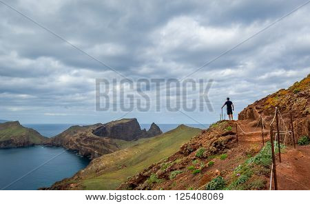 Men hiking at the hills of Madeira volcanic landscape. East coast of Madeira island, Portugal.
