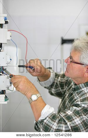 Portrait of a man working on a circuit breaker