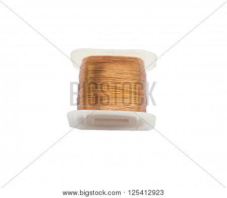 coil of copper wire on white .