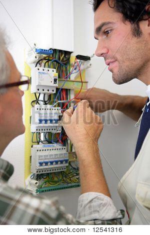 Men working on a circuit breaker