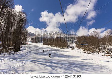 ROSA KHUTOR, RUSSIA - MARCH 31, 2016: View of slopes of Rosa Khutor ski resort