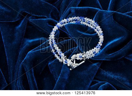 Luxury necklace on blue velvet, close image