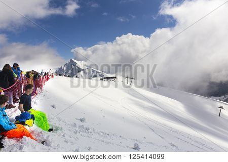 ROSA KHUTOR, RUSSIA - MARCH 31, 2016: Tourists and riders at Rosa Peak top 2320 meters height