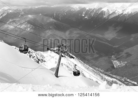 ROSA KHUTOR, RUSSIA - MARCH 31, 2016: Scenery mountain top view from Rosa Peak with cable ski elevator