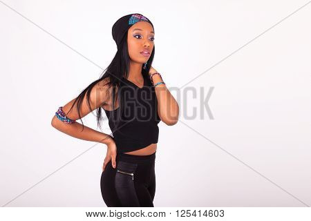 Beautiful African American Woman Wearing A Headband Isolated On White Background