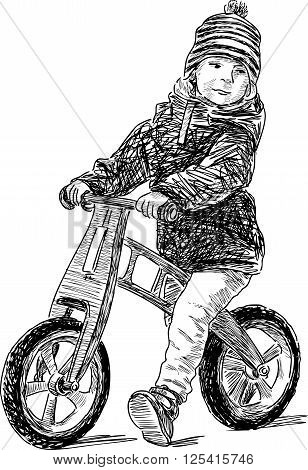 Vector drawing of a little boy on a bicycle.