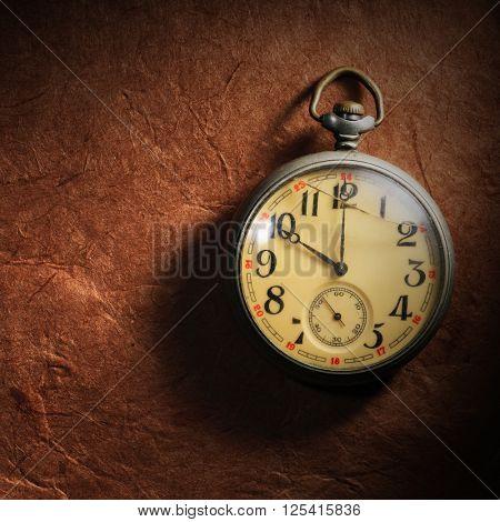 vintage clock on paper background