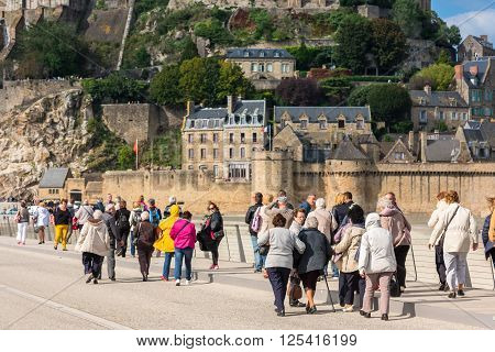 Group Of Old People Visiting Mont Saint Michel Monastery
