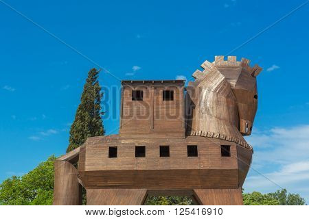 TRUVA, TURKEY - APRIL 29, 2015: Modern wooden sculpture of Trojan horse on place of ancient Troy